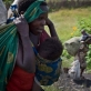 A woman and her family flee ongoing fighting between M23 rebels and Congolese Government. Kate Holt.