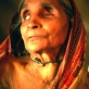 Aisha Begum is 80 years old and a widow. She has still not been able to access a pension. Kate Holt.