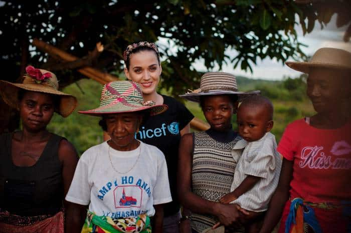 Katy Perry poses for a photograph with women wearing beautiful hats. Kate Holt.