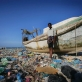 Haziz, an economic migrant from Ethiopia's Ogaden region, stands next to a boat. Kate Holt.