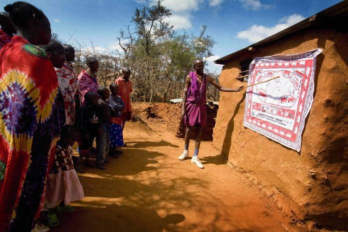 Lester Moitai teaches village women about the SAFE strategy, that helps to prevent trachoma. Kate Holt.