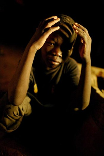 A young street boy in one of Juba's many market places. Kate Holt.