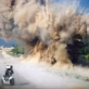 A controlled explosion is detonated by a British CIED team on a 2.5 km stretch of road. Kate Holt.