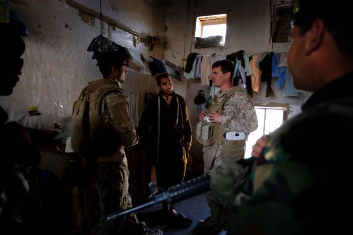 US Marines talk with an Afghan man in Lakari Bazaar, Garmsir District. Kate Holt.