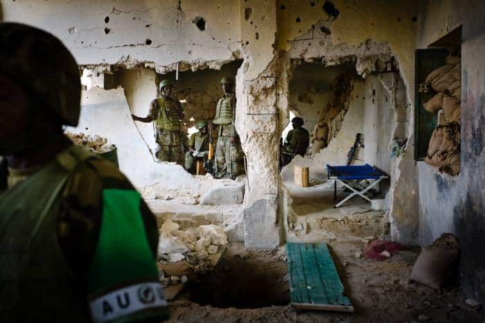 AMISOM soldiers man positions in a house in the Sigaale District of Mogadishu. Kate Holt.
