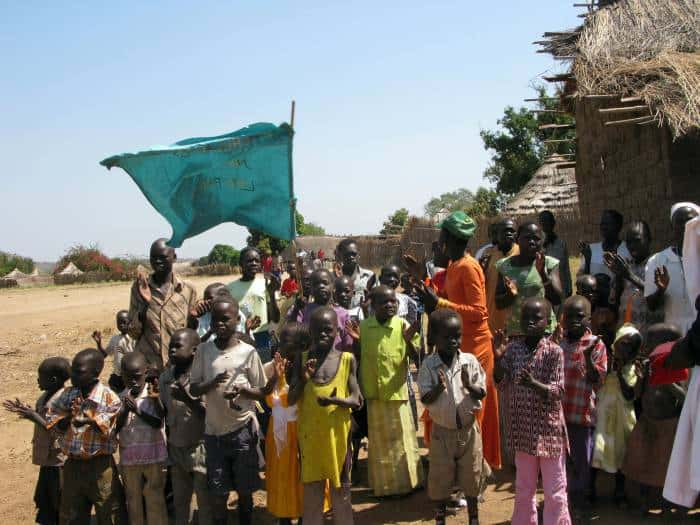 A group of school children stand outside the Chapel in Ngangala village. Kate Holt.