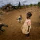 Maua Juma plays with her cousins outside her grandmother's home in the town of Makuyuni. Kate Holt.