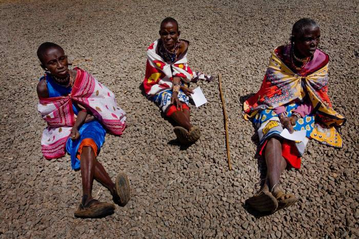 50 year old Seteiy Makoi from Emaarit Town sits on the ground awaiting an operation for her trachoma. Kate Holt.
