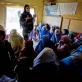 Salgi Azizi gives a health education talk about the importance of vaccinating their children. Kate Holt.