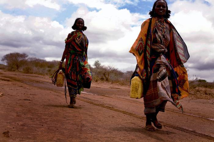 As a result of a severe drought in Southern Ethiopia, women have to walk many miles to collect water. Kate Holt.