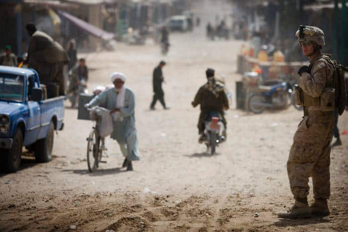 A US Marine patrols Lakari Bazar that has been rehabilitated by US Marines in Lakari. Kate Holt.