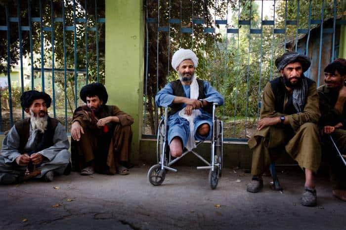 An elderly man who lost both his legs in an IED blast near Zhari District of Kandahar. Kate Holt.