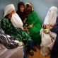 Women in the burkas look at a newborn baby in the maternity unit at the Provincial Hospital. Kate Holt.