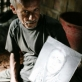 Shadan Chanedaey is 80 years old. His son has thrown him out of his house, and he now lives in a shed. Kate Holt.