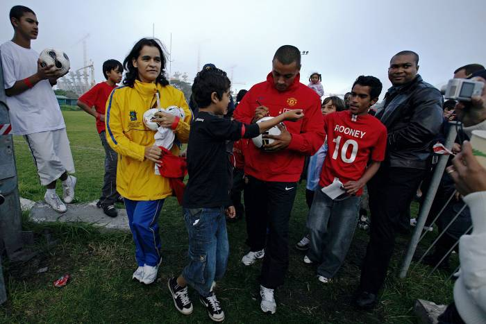 Danny Simpson, defender for Manchester United, signs autographs the day after the opening game. Kate Holt.