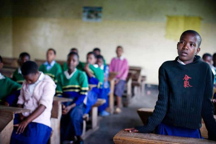 Nastura, who was forced to leave Makuyuni Primary School after her grandmother died, poses for photographs. Kate Holt.