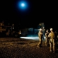 Lt Bales of 2/2 US Marines briefs his troops beneath a full moon before carrying out a night patrol. Kate Holt.