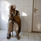 An elderly man waits to be seen by a doctor in the Emergency Room of the Bost Hospital. Kate Holt.