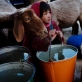 A young girl feeds her goats in the village of Borlak Paein in Bamyan Afghanistan. Kate Holt.