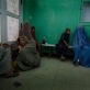 Burka clad women and their children sit in the waiting room of Mirwais Hospital. Kate Holt.