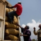 The dried beans are loaded onto a truck before it is taken to the nearby coffee mill to be ground for sale. Kate Holt.