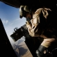An ISAF (International Securitisation Assistance Force) gunner keeps watch out the side of a helicopter. Kate Holt.