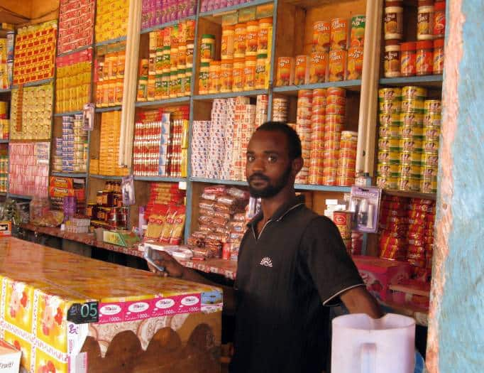 Mohammed stands in his grocery shop in Atlabara, Juba Southern Sudan. Kate Holt.