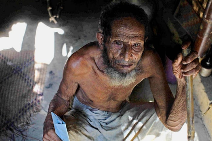 Sidik Ahmed is over 100 years old and lives with his daughter and four grandchildren. Kate Holt.