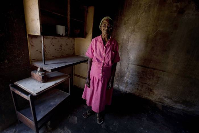 Jesca Seremani, who has lost seven of her eight children to aids, poses for a photograph. Kate Holt.