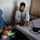 A young boy has his chest examined by a doctor at Woch Tangai Health Centre. Kate Holt.