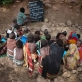 Children attend school which is held under a thorn tree in the woreda of Geega, near Logya. Kate Holt.