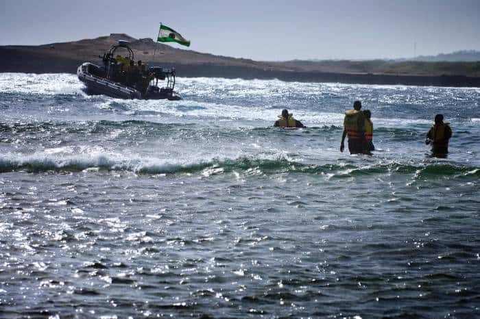 Ugandan Marines launch their boat in the sea near Mogadishu Airport. Kate Holt.