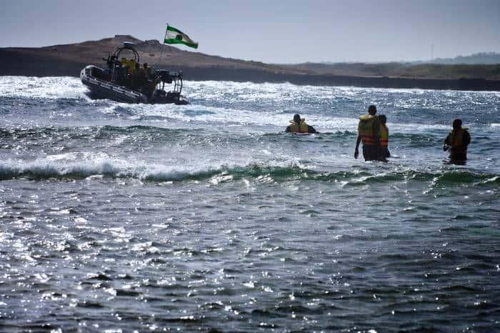 Ugandan Marines launch their boat in the sea near Mogadishu Airport. Kate Holt.