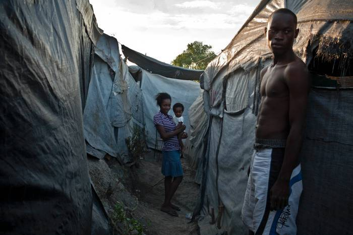 A scene shows people still living in camps in Port au Prince, Haiti on the 17th January, 2013. Kate Holt.