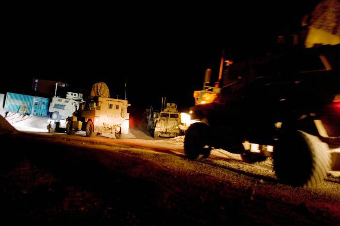 Armored vehicles leave for a night patrol from the base of the 2-508, 82nd Airborne Division of the US army. Kate Holt.