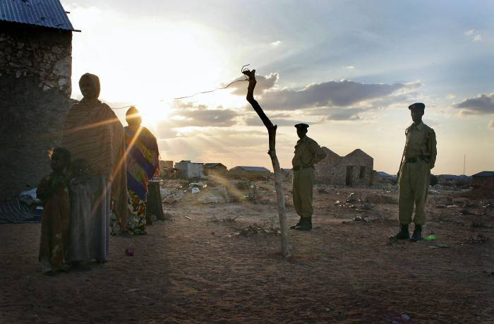 A woman and her children in a settlement for displaced people in South Galkayo, Somalia. Kate Holt.