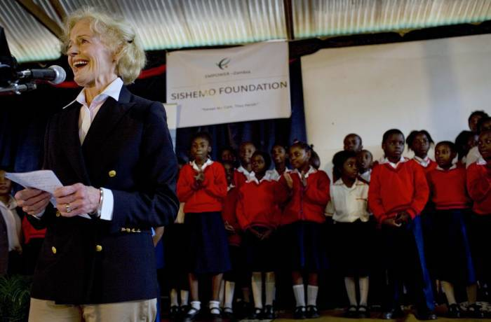 Quentin Bryce, AC, Governor General of Australia, addresses an audience and school children at the Sishemo Project. Kate Holt.