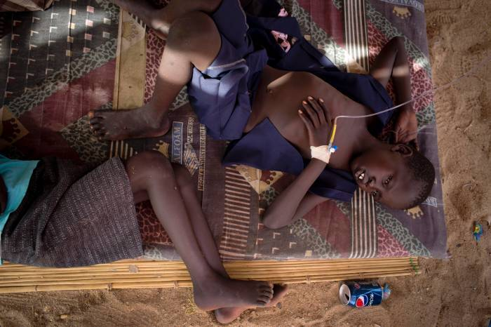 Children suffering from diarrhea get treated in a private clinic in a tent in Mingkaman, South Sudan. Kate Holt.