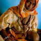 A young mother holds her malnourished child at a therapeutic feeding centre that is run by UNICEF. Kate Holt.