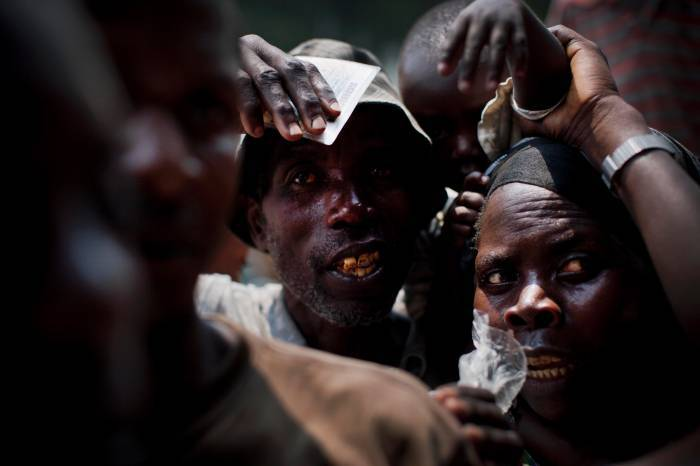 Families displaced by recent fighting between M23 rebels and Congolese Government soldiers. Kate Holt.