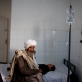 Salim, an eight year old boy, accompanied by his grandmother, Hajji, is treated for an allergy to some medicine. Kate Holt.