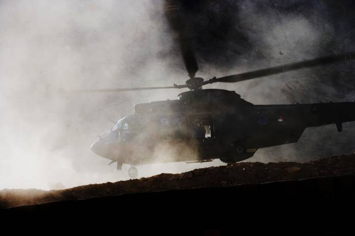 A helicopter lands in a cloud of dust at the base of 2-508, 82nd Airborne Division of the US army. Kate Holt.