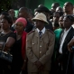 Mourners gather at the burial of President Kenyatta's nephew. Kate Holt.