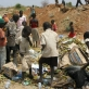 Young children hunt through a rubbish dump for food at a dumping site twelve miles outside of Juba. Kate Holt.