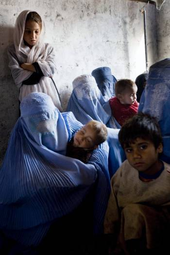 Women wait with their children to be vaccinated as part of a 3 day nation wide vaccination campaign. Kate Holt.