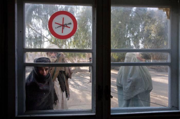 People wait outside the Emergency Room at the Bost Hospital, Lashkar Gah, Helmand, Afghanistan. Kate Holt.