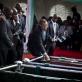Mourners gather around the coffins of President Kenyatta's nephew Mbugua Mwangi and his fiancee. Kate Holt.