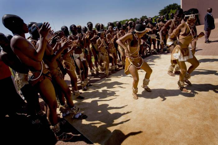 Traditional Kalahari dancers perform for Quentin Bryce the Governor General of Australia on upon her arrival in Gaborone. Kate Holt.