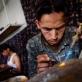 Workers make jewellery in the workshop of Javed Noori in Kabul. Kate Holt.