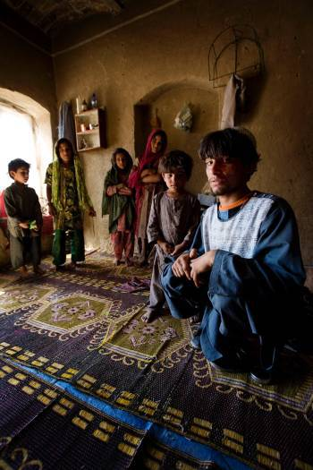 Olghaum Sakhi sits with some of his nieces and nephews. Kate Holt.